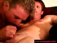 Two middle aged hairy men experiment with blowing cocks