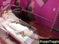 Asian masseuse massaging clients cock
