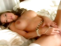 Crissy Morgan is a hot babe showing off her big tits and masturbates