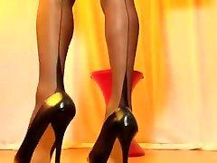 SEXYPUTA WEARING BLACK MINI SKIRT AND BLACK SEAMED NYLON STOCKINGS