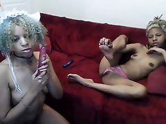 Lesbian ebony and latina toying