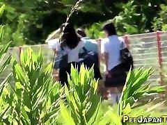 Asian teens skirt in ass outside