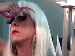 Lara in long nails putting on lashes