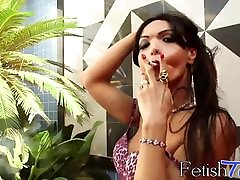 Big booty shemale in sexy lingerie smokes and teases