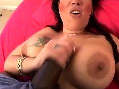 Big boobed MILF tugging black cock