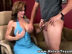 Mature busty handjob milf tugging on cock
