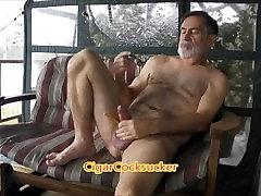 CigarCockSucker..smoking and stroking pumped cock