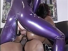 Black chick with big tits gets fucked by guy as she sucks another on the sofa
