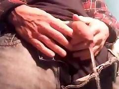 Uncut cock pissing through long foreskin