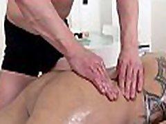 Sexy white hunk is enjoying a lusty massage from dark stud
