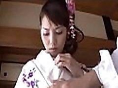 Asian honey sucks a dildo while enjoying doggystyle sex