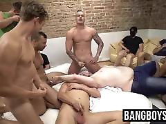Masked gay studs sucking dick and spraying cum at an orgy