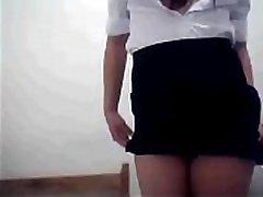 Filipina SM saleslady Snow Bernardo strips out of her work uniform