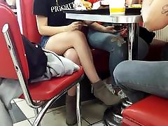 candid teen sexy crossed legs under table