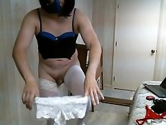 Crossdresser trying on different panties 3