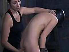 Caged up beauty is forced to give stud wild dick sucking