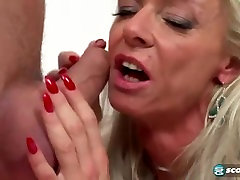 MILF has her way with a muscular dude
