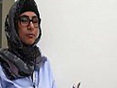 Arab babe disrobes inside the library and starts masturbating
