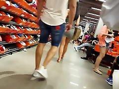 Candid voyeur hottie in tight dress shopping beautiful
