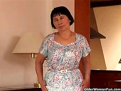 Over 70 granny does striptease and masturbates