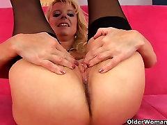 Blonde grandma in black stockings fucks herself