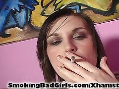 Teen smokes white cigarette