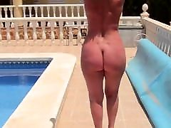 Mature with a wwwnew sex videocom bare ass walks by the pool