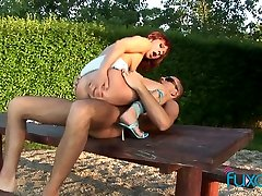 Real red haired slut rides stiff sloppy cock on the picnic table