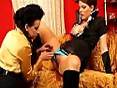 Alluring lesbo babe gets fucked hard with a big thong on