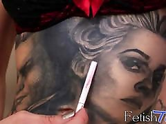 Stunning tattooed shemale takes a smoke and teases solo
