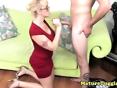Amateur mature MILF with glasses jerking dong