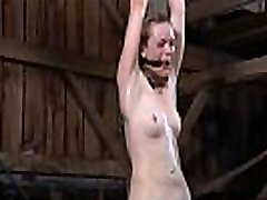 Chained darling gets excruciating caning on her skinny body