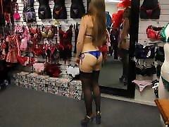 Brazilian girl in mini-bikini, stockings and high heels