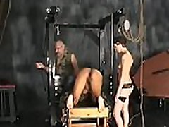 Nude woman stands and endures coarse bondage dilettante