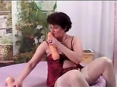 Chubby granny in white stockings starts teasing young male's dick