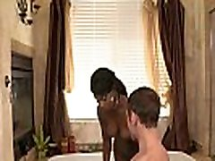 Ebony babe massaging clients cock