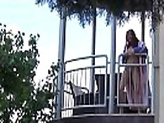 Redhead pees over her balcony in the city