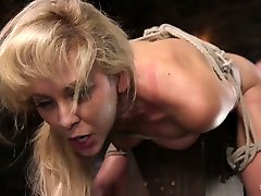 Tied up and suspended seductress Cherie Deville gets her pussy toyed