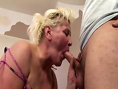 Granny is fucking a hard cock