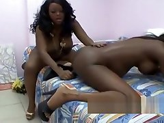 Ebony lesbians connecting pleasure with a firm dildo