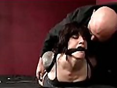 Bitch gewalt blowjob a ball gag in her mouth while being strapped to ottoman