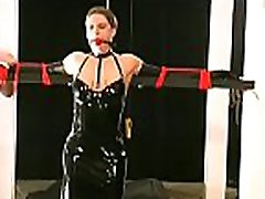 Resigned babe stands and endures heavy breast bondage porn