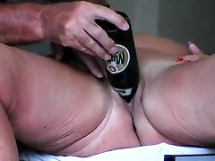 Mature woman toys pussy in homemade solo scene