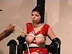 Naked woman shows off in complete breast bondage x movie scene