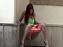 Watch this hot redhead pissing in public!