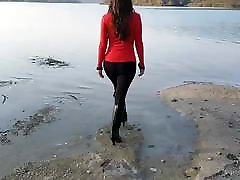 High heeled leather boots in river