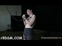 Masked beauty with exposed cunt receives wild thrashing