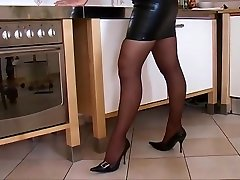 Nice Woman in Tight leather dress High Heels and Boots