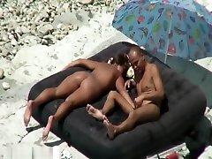 Oiled horny babe sunbathing