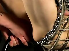 Gay bondage porn Aaron finds himself trussed into the iron s